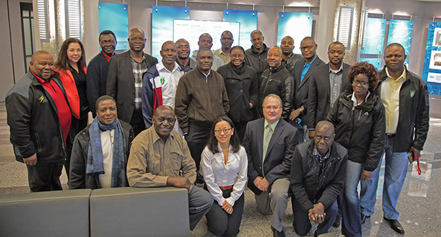 NYISO's Yachi Lin and Wes Yeomans pose with members of the Southern African Power Pool.