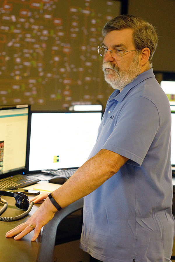 Kenneth Lizke, shift supervisor of the Control Room, looks at multiple screens of information during a recent day at NYISO's Control Room Simultor.